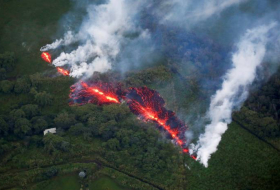 Hawaii volcano explosions shoot ash to 11,000ft as lava swamps road - NO COMMENT