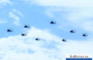 Azerbaijan's military helicopters continue flights over Baku in preparation for parade