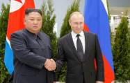 First handshake: Putin greets Kim on historic visit to Russia -  VIDEO
