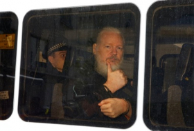 Assange used embassy as spy center, Ecuador's president says