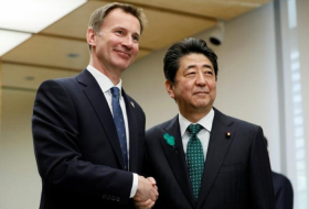 Hunt tells Japan's PM Britain determined to avoid no-deal Brexit