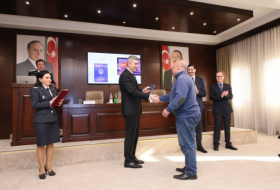 Azerbaijan State Migration Service presents travel documents to refugee status holders