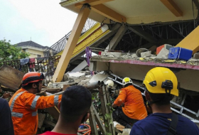 Indonesia quake toll hits 56 as rescuers race to find survivors