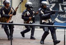 Venezuelan police seal off parliament, four MPs accused of treason