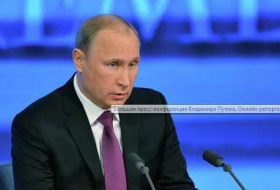 Putin says Russia economy will be cured but offers no remedy